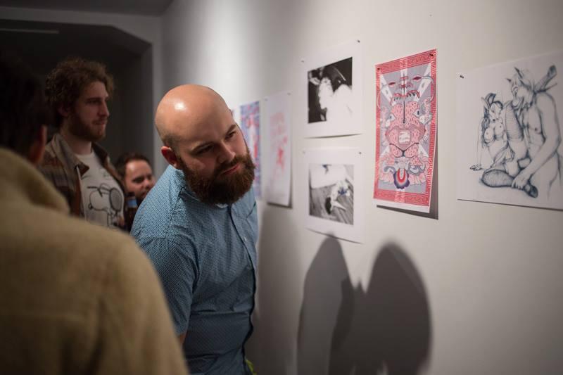 Ben Cowan looking at Lucia Love's Risograph Print NSFW, Risograph Print Show