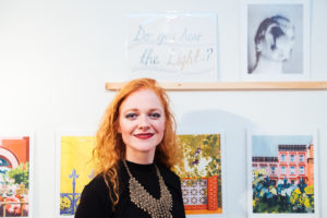 """Cecilie Beck, in front of her Risograph print """"Do you hear the light?"""""""
