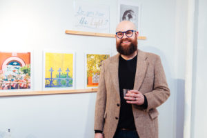 Brooklyn artist Ben Cowan, with his prints and homebrewed beer.