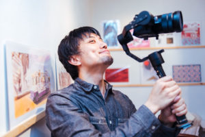 Kensuke Sato, filming the opening reception of Drums on Paper III